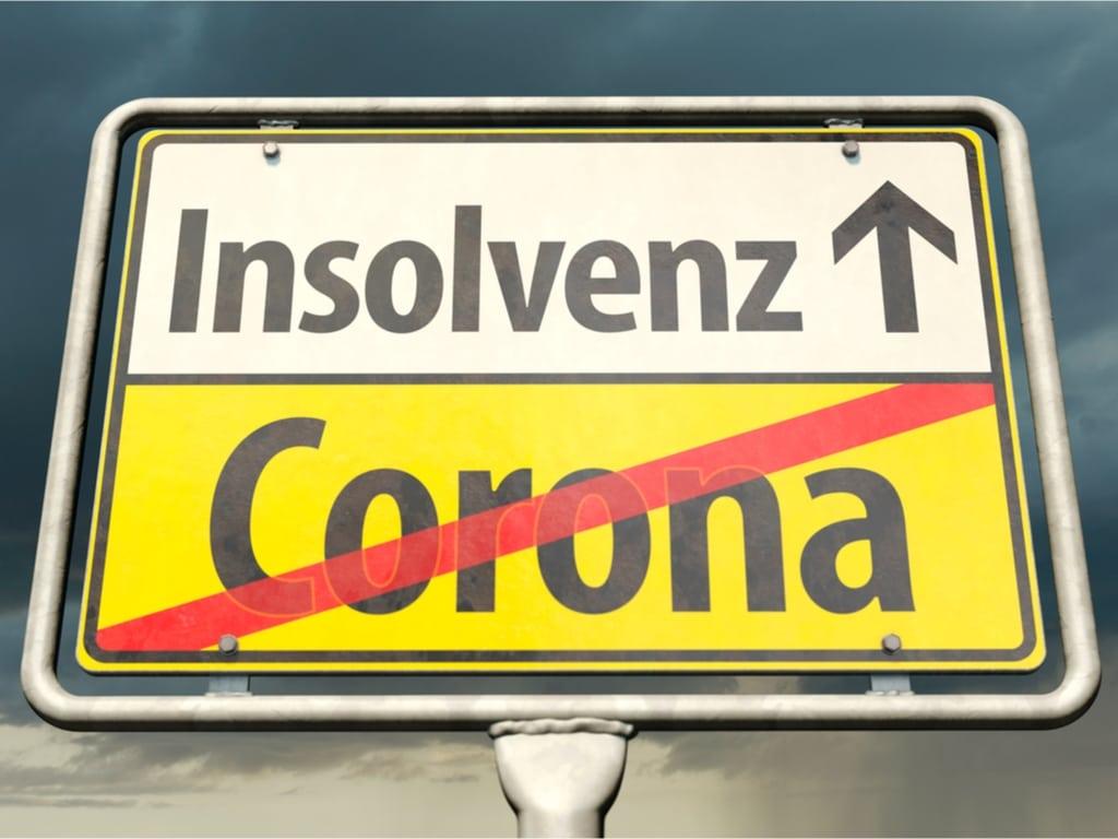 Straßenschild: Von Corona in die Insolvenz